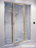 brass-framed shower door