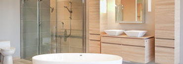 bathroom showroom with glass shower display